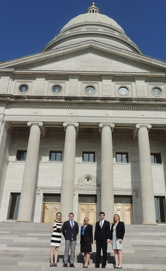 Image of Attorney General Law Clerks in front of Capitol